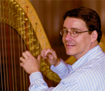 Peter Wiley regulating a harp